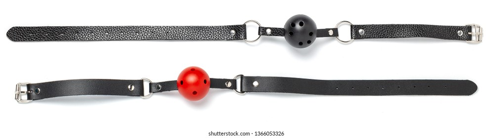 Red Ball gag in mouth isolated on white background. Intimate toys. Sex abuse slavery.