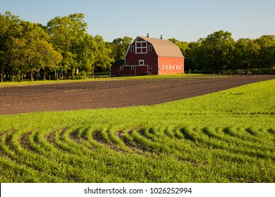A red barn and agriculture fields in North easter North Dakota.