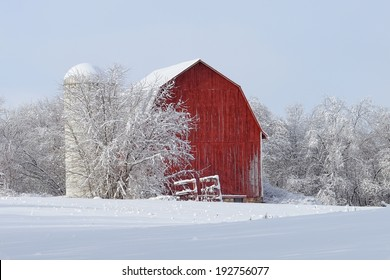 Red Barn covered with snow Winter countryside in Michigan
