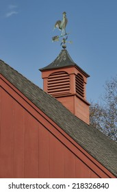 Red barn with cupola and rooster weathervane