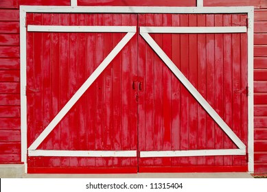 Red barn doors with the supports on the outside.
