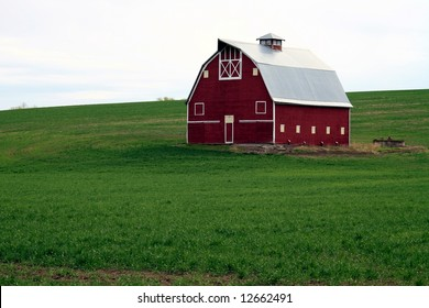Red Barn in Green Field