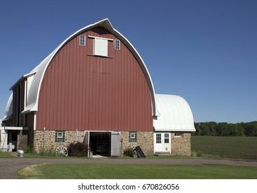 A red barn with metal siding and stone foundation on a Wisconsin farm