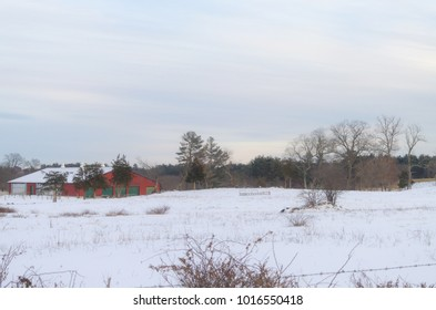 Red barn in middle of snow