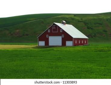 Red Barn Nestled in Green Hills