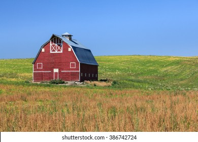 Red Barn on Green Field with Blue Sky