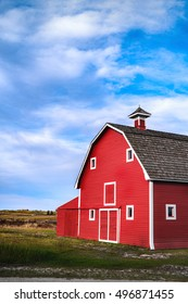 Red barn in a prairie countryside.