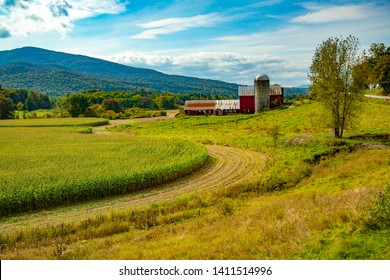 Red barn with silo and corn field on a farm near Waterville, VT