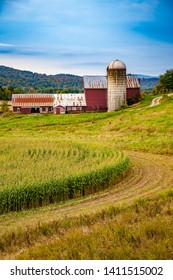 Red barn with silo and corn field near Waterville, VT