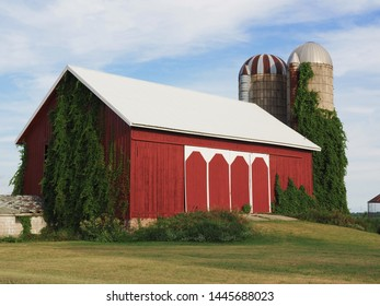 Red barn with writing and skyline
