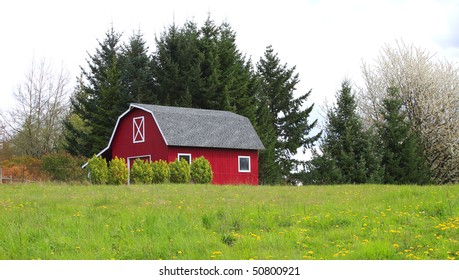 Red barn-house in a country.