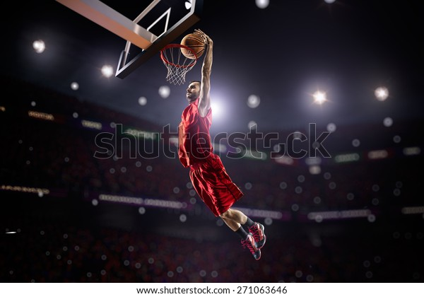 red Basketball player in action in gym