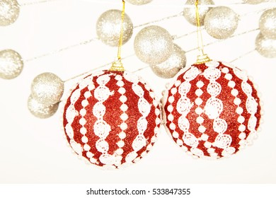 Red baubles ,hand made , christmas decorations ,white ,background, glitter ,many ,ornaments ,december ,winter ,celebration ,holidays ,heart ,silver ,season ,pink roses