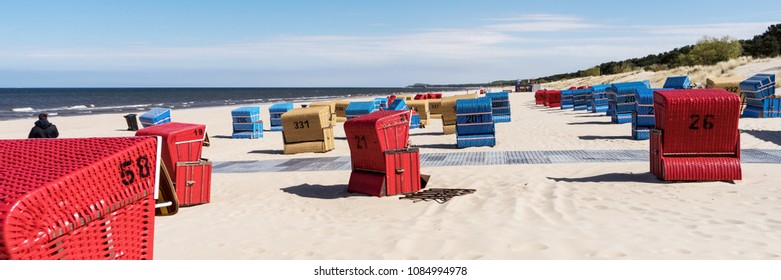 Red beach chairs on a sunny day at the Baltic Sea