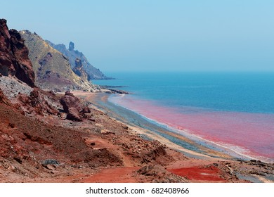Red beach on the Iranian island of Hormuz, Hormozgan Province, Southern Iran, Colorful soil is a main attraction of the island, located in Hormuz Strait, Persian Gulf.