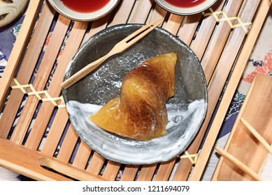 Red bean alkaline zongzi with tea on the table