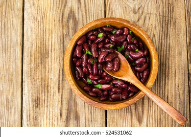 Red beans boiled in wooden bowl. Studio Photo