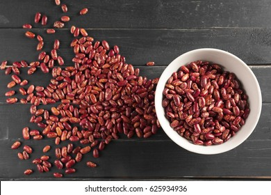 Red beans on wooden table
