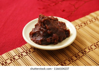 red beans paste on white plate, red background, Japanese style
