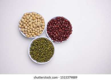 red beans, soybeans and green beans in a white bowl with white background