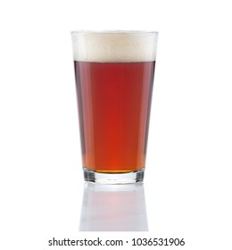 Red beer IPA with gentile foam in clear beer glass isolated on white background with glass reflection