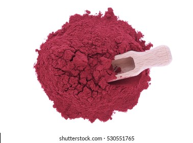 red beetroot powder and wooden spoon