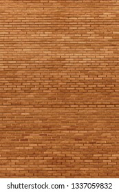 Red beige bricks stone wall decorative background closeup, vertical grunge pattern, old aged weathered texture, natural grungy textured reddish vintage, rough rustic brick birckwork