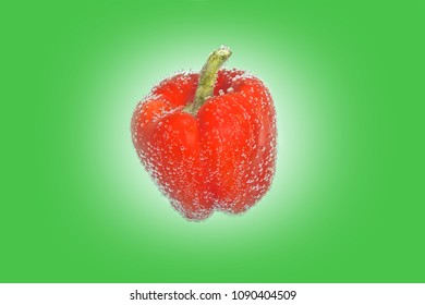 red bell pepper with bubbles of soda on a green background
