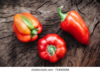 Red bell peppers.sweet paper.wood background.