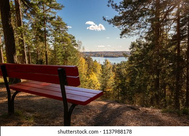 Red bench and lake Pyhäjärvi in Tampere, Finland