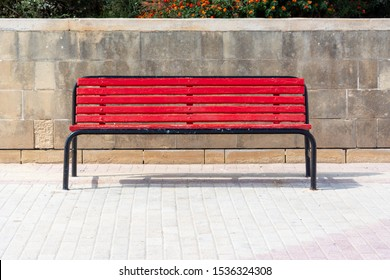 Red bench on sunny day