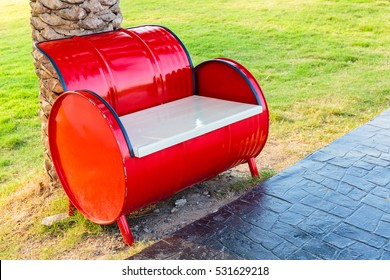 Red bench in the park, adapted from gasoline tank and wood window