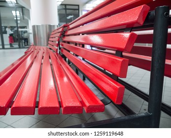 Red bench in a public waiting room