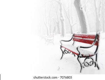 Red benches in the fog in winter with space for text