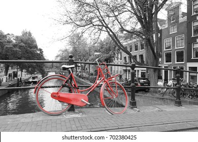 red bicycle on the bridge Amsterdam, Black and white photo amsterdam