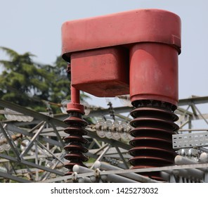 RED  BIG device called automatic voltage regulator to change the voltage of the transformer in function of the electric load absorbed by the user