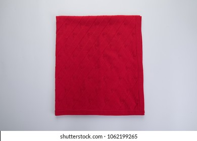 Red big spa towel or blanket with seashells