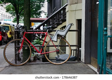 Red Bike with baby chair parked on one sidewalks of New York City & Bicycle Baby Chair Images Stock Photos u0026 Vectors | Shutterstock