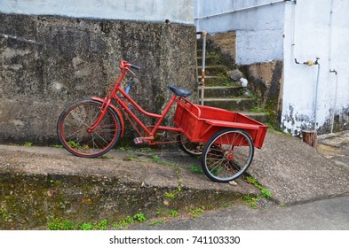 Red bike with three wheels