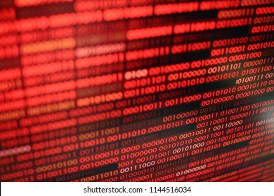 red binary code. computer technology background. red binary code computer language data transfers. unsecured and dangerous big data and ai artificial intelligence cyber network.