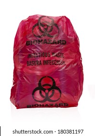 Red Bio-hazard Bag Filled with Medical Waste. Medical waste filled red bio-hazard bag on white background. Regulated medical waste reduction and minimization practices.