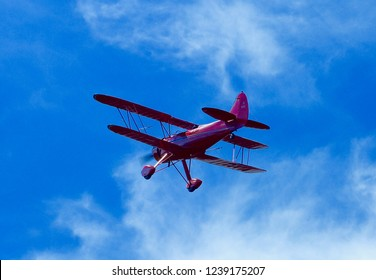 Red Biplane in flight