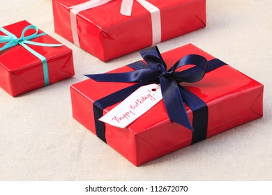 Red Birthday (christmas) presents with blue ribbon
