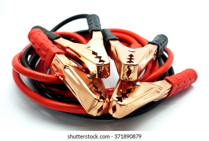 Red and black car battery bumper cable, isolated on white background. Focus on metal.
