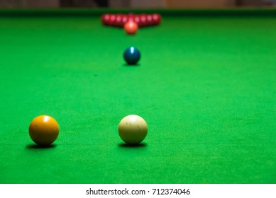 Red, Black and color Ball on the snooker table, man play snooker.