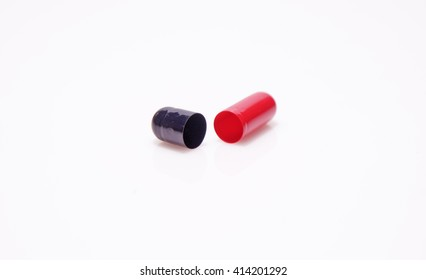 red and black colored capsule opened.