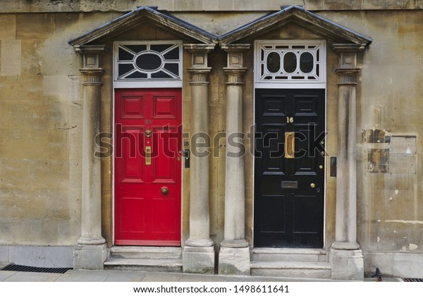 Red and black doors on the side of road, Oxford, United Kingdom. Photo was taken on 07/08/2019.