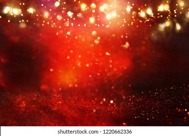 Red, black and gold glitter lights background. defocused