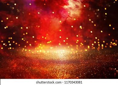 Red, black and gold glitter vintage lights background. defocused