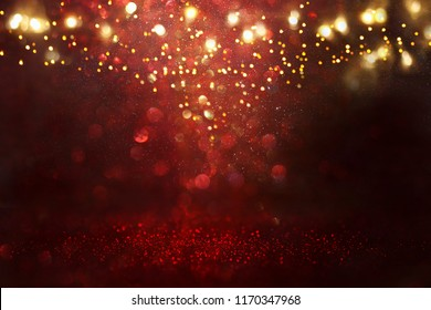 Red, black and gold glitter vintage lights background. defocused